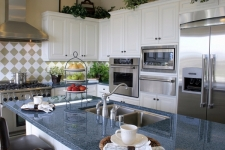 Blue-pearl-granite-kitchen-countertop-white-cabinets-kitchen-island-with-seating